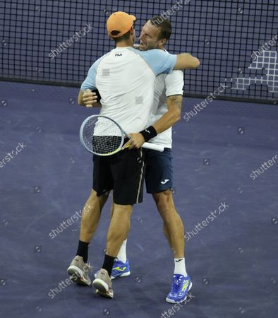John Peers of Australia (L) and Filip Polasek of Slovakia (R) celebrate after defeating Aslan Karatsev of Russia and Andrey Rublev of Russia in the men's doubles final at the BNP Paribas Open tennis tournament at the Indian Wells Tennis Garden in Indian Wells, California, USA, 16 October 2021.