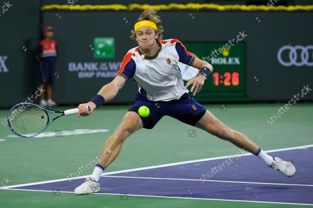 Andrey Rublev, of Russia, who was playing with doubles partner Aslan Karatsev returns a volley from John Peers, of Australia, and Filip Polasek, of Slovakia, in the doubles final at the BNP Paribas Open tennis tournament, in Indian Wells, Calif