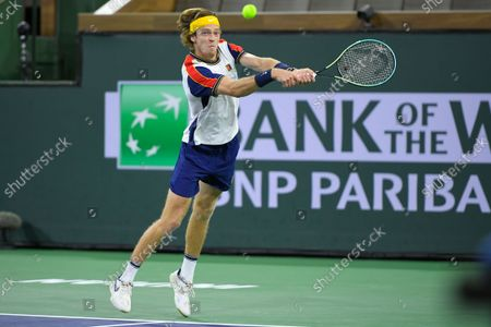 Andrey Rublev, of Russia, playing with partner Aslan Karatsev, of Russia, returns a volley from John Peers, of Australia, and Filip Polasek, of Slovakia, in the men's doubles final at the BNP Paribas Open tennis tournament, in Indian Wells, Calif