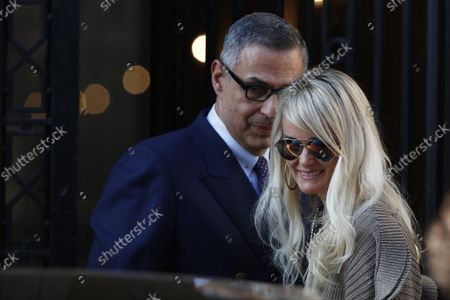 """Stock Image of Laeticia Hallyday comes out of the restaurant Laeticia Hallyday comes out of Cyril Lignac's restaurant """"Le Bar des Prés"""" where she had lunch with Jean-Claude Camus where she had lunch with Jean-Claude Camus. Then Sebastien Farran and Laeticia Hallyday are coming out of an appointment with her lawyer Ardavan Amir-Aslani Avenue Montaigne. Then then Laeticia Hallyday and her daughters Jade and Joy stops at rue de Rivoli to visit a friend in Paris, France. On October 9, 2018."""