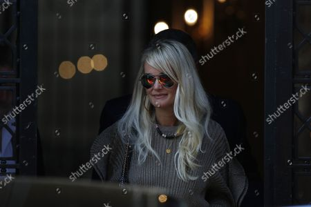 """Stock Photo of Laeticia Hallyday comes out of the restaurant Laeticia Hallyday comes out of Cyril Lignac's restaurant """"Le Bar des Prés"""" where she had lunch with Jean-Claude Camus where she had lunch with Jean-Claude Camus. Then Sebastien Farran and Laeticia Hallyday are coming out of an appointment with her lawyer Ardavan Amir-Aslani Avenue Montaigne. Then then Laeticia Hallyday and her daughters Jade and Joy stops at rue de Rivoli to visit a friend in Paris, France. On October 9, 2018."""