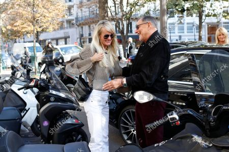 """Laeticia Hallyday comes out of the restaurant Laeticia Hallyday comes out of Cyril Lignac's restaurant """"Le Bar des Prés"""" where she had lunch with Jean-Claude Camus where she had lunch with Jean-Claude Camus. Then Sebastien Farran and Laeticia Hallyday are coming out of an appointment with her lawyer Ardavan Amir-Aslani Avenue Montaigne. Then then Laeticia Hallyday and her daughters Jade and Joy stops at rue de Rivoli to visit a friend in Paris, France. On October 9, 2018."""