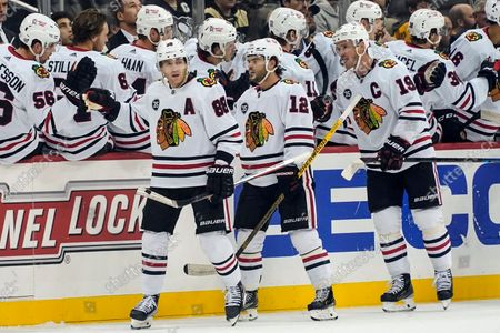 Stock Picture of Chicago Blackhawks' Patrick Kane (88) celebrates with teammates after scoring against the Pittsburgh Penguins during the second period of an NHL hockey game, in Pittsburgh