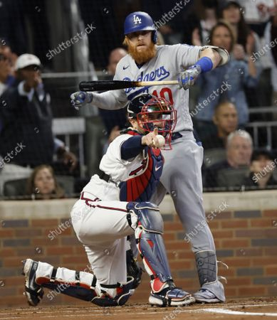 Los Angeles Dodgers batter Justin Turner (R) and Atlanta Braves catcher Travis d' Arnaud (L) reacts as Turner is called out on strikes in the top of the first inning of game 1 of the MLB National League Championship Series playoff baseball game between the Los Angeles Dodgers and the Atlanta Braves at Truist Park in Atlanta, Georgia, USA, 16 October 2021.