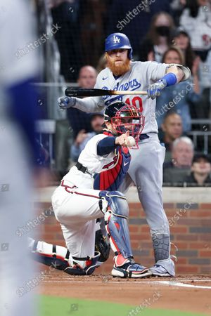 Atlanta Braves catcher Travis d'Arnaud points for a review on a pitch to Los Angeles Dodgers' Justin Turner during the first inning in game one in the 2021 National League Championship Series at Truist Park on Saturday, Oct. 16, 2021 in Atlanta, GA.(Robert Gauthier / Los Angeles Times)