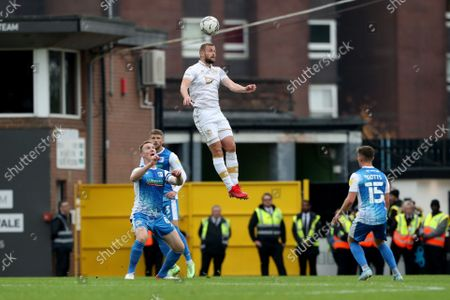 Port Vale's James Wilson wins a header during the Sky Bet League 2 match between Port Vale and Barrow at Vale Park, Burslem on Saturday 16th October 2021.