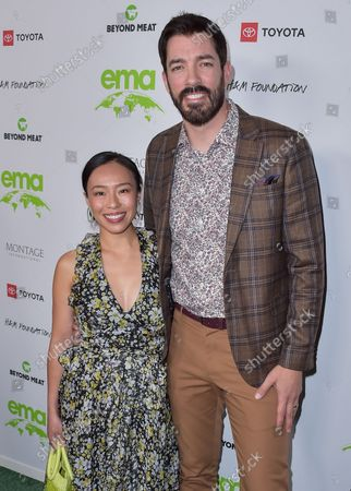 Linda Phan and husband/television personality Drew Scott arrive at the Environmental Media Association (EMA) Awards Gala 2021 held at GEARBOX LA on October 16, 2021 in Van Nuys, Los Angeles, California, United States.
