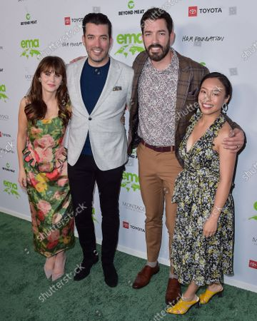 Actress Zooey Deschanel, Jonathan Scott, Drew Scott and Linda Phan arrive at the Environmental Media Association (EMA) Awards Gala 2021 held at GEARBOX LA on October 16, 2021 in Van Nuys, Los Angeles, California, United States.