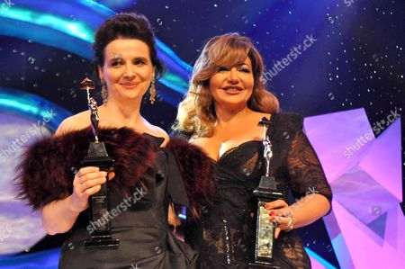 Stock Photo of Juliette Binoche and Leila Alwi show their honorary awards during the opening ceremony