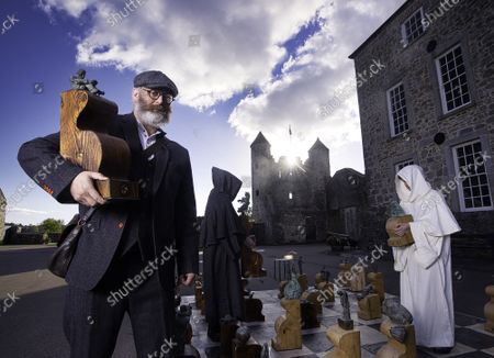 Stock Image of Pictured are artist Alan Milligan and chess movers Chris Bland and Jack Murphy