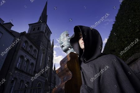 Stock Photo of Pictured with the Black Queen Beckett chess piece is chess mover Chris Bland