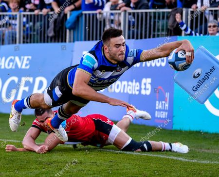 Will Muir of Bath reaches for the line and scores a try under pressure from Sean Maitland of Saracens; The Recreation Ground, Bath, Somerset, England; Gallagher Premiership Rugby, Bath versus Saracens.