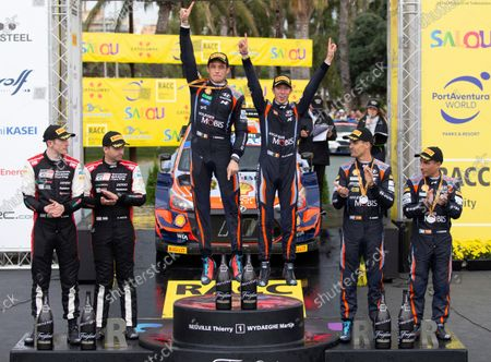 Belgian Thierry Neuville (3-L), and co-driver Martijn Wydaeghe (3-R), celebrate their victory next to second placed British Elfyn Evans (L) and co-driver Scott Martin (2L) and third placed Spanish Dani Sordo (2-R), and co-driver Candido Carrera (R) following the RACC Rally Catalonia-Costa Daurada as part of the 2021 World Rally Championship (WRC), in La Granadella, Catalonia, Spain, 17 October 2021.