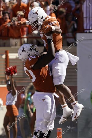 Texas running back Bijan Robinson (5) celebrates his touchdown against offensive lineman Christian Jones (70) during the second half of an NCAA college football game in Austin, Texas