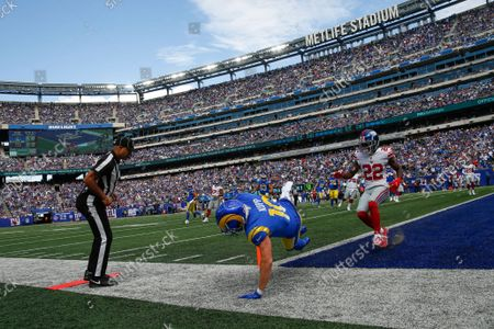 Stock Photo of Los Angeles Rams' Cooper Kupp, center, scores a touchdown as New York Giants' Adoree' Jackson, right, looks on during the first half of an NFL football game, in East Rutherford, N.J