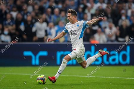 Marseille's Arkadiusz Milik scores his side's third goalduring the French League One soccer match between Marseille and FC Lorient at the Velodrome stadium in Marseille, France