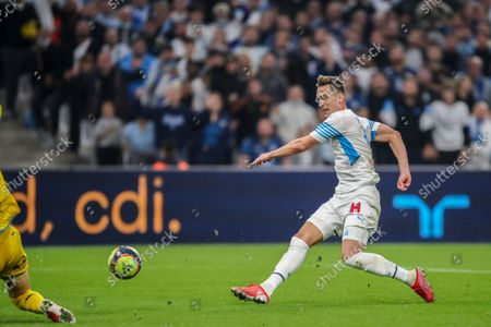 Stock Photo of Marseille's Arkadiusz Milik scores his side's third goalduring the French League One soccer match between Marseille and FC Lorient at the Velodrome stadium in Marseille, France
