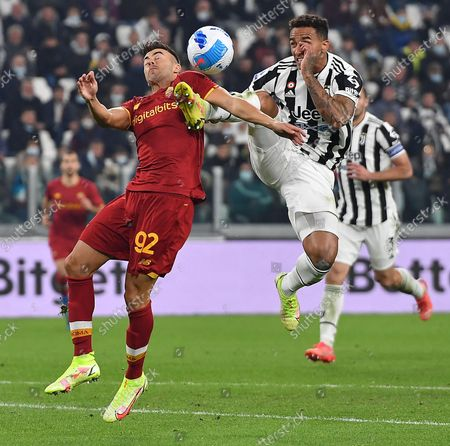 Juventus' Danilo (R) and Roma's Stephan El Shaarawy in action during the Italian Serie A soccer match Juventus FC vs AS Roma at Allianz Stadium in Turin, Italy, 17 october 2021.