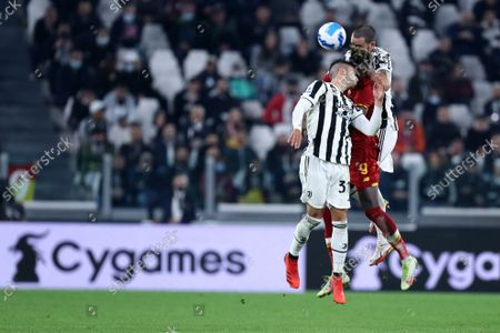 Rodrigo Bentancur, Leonardo Bonucci of Juventus Fc and Tammy Abraham of As Roma battle for the ball during the Serie A match between Juventus Fc and As Roma at Allianz Stadium on October 17, 2021 in Turin, Italy.