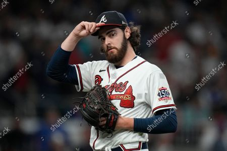 Atlanta Braves pitcher Ian Anderson walks back to the dugout during the first inning in Game 2 of baseball's National League Championship Series, in Atlanta