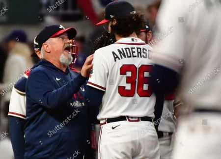 Stock Image of Atlanta Braves pitching coach Rick Kranitz talks to starting pitcher Ian Anderson in the 1st inning in game two of the MLB NLCS against the Los Angeles Dodgers at Truist Park in Atlanta, Georgia on Sunday, October 17, 2021.