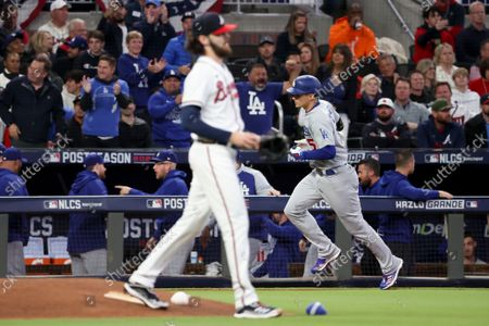 Stock Photo of Los Angeles Dodgers' Corey Seager, right, rounds the bases after hitting a two-run home run off of Atlanta Braves starting pitcher Ian Anderson during the first inning in game two in the 2021 National League Championship Series at Truist Park on Sunday, Oct. 17, 2021 in Atlanta, GA.(Robert Gauthier / Los Angeles Times)