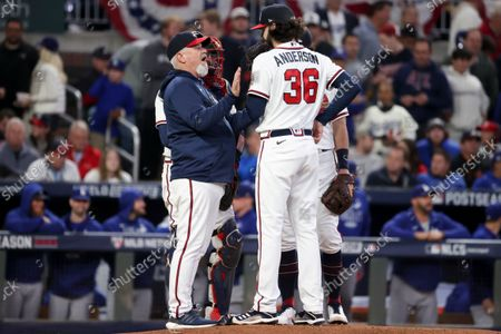 Stock Picture of Atlanta Braves pitching coach Rick Kranitz, left, speaks with Ian Anderson during the first inning in game two in the 2021 National League Championship Series against the Los Angeles Dodgers at Truist Park on Sunday, Oct. 17, 2021 in Atlanta, GA.(Robert Gauthier / Los Angeles Times)