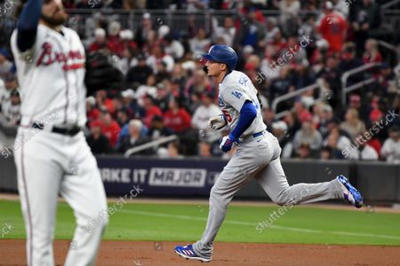 Los Angeles Dodgers' Corey Seager, right, rounds the bases after hitting a two-run home run off of Atlanta Braves starting pitcher Ian Anderson during the first inning in game two in the 2021 National League Championship Series at Truist Park on Sunday, Oct. 17, 2021 in Atlanta, GA.(Wally Skalij / Los Angeles Times)