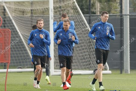 Club's Mats Rits, Club's Ruud Vormer and Club's Hans Vanaken pictured during a training session of Belgian soccer team Club Brugge, Monday 18 October 2021, in Brugge, in preparation of tomorrow's Champions League game against English club Manchester City, the third game(out of six) in the Group A of the UEFA Champions League group stage.