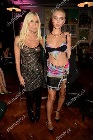 Donatella Versace and Iris Law
