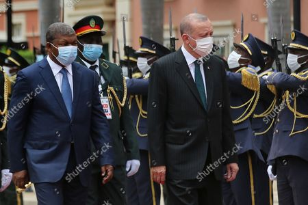 Angolan President Joao Lourenco (L) and Turkish counterpart Recep Tayyip Erdogan (R) during the honour guard ceremonies at the Presidential Palace in Luanda, Angola, 18 October 2021. Erdogan is currently on a state visit to Angola.