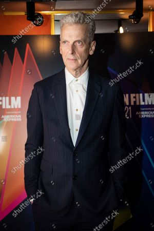 Peter Capaldi poses for photographers upon arrival at the premiere of the film 'Benediction' during the 2021 BFI London Film Festival in London