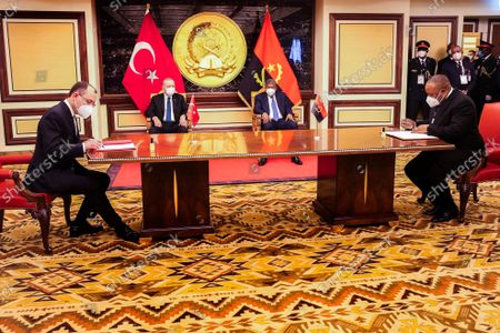 Angola President Joao Lourenco (C/R) and Turkish counterpart Recep Tayyip Erdogan (C/L) looks on during the signature of bilateral agreements at Presidential Palace in Luanda, Angola, 18 October 2021.