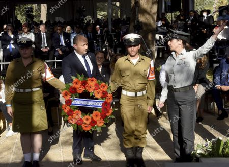 Israeli Prime Minister Naftali Bennett prepares to lay a wreath at the state memorial ceremony for the late Prime Minister Yitzhak Rabin at the Mt. Herzl Cemetery in Jerusalem, . Israel is marking 26 years since Rabin was assassinated by Yigal Amir, an extremist Jewish Israeli