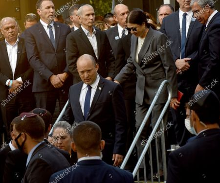 Israeli Prime Minister Naftali Bennett, center, attends the state memorial ceremony for the late Prime Minister Yitzhak Rabin at the Mt. Herzl Cemetery in Jerusalem, . Israel is marking 26 years since Rabin was assassinated by Yigal Amir, an extremist Jewish Israeli