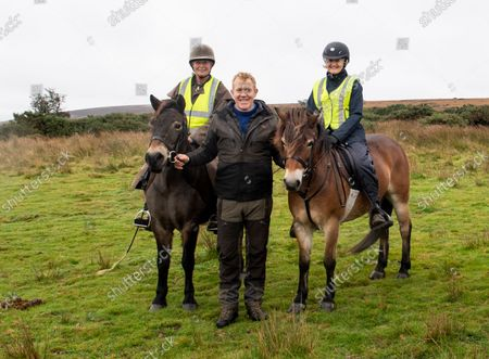"""Adam Henson joins The annual round up of the Anchor Herd of Exmoor Ponies was held today on Exmoor The herd are gathered in off the moor for their annual health checks. The Exmoor has been given """"endangered"""" status by the Rare Breeds Survival Trust, and """"threatened"""" status by The Livestock Conservancy. It is one of the British Isles' mountain and moorland pony breeds, having conformation similar to that of other cold-weather-adapted pony breeds. The Exmoor pony is hardy and used for a variety of equestrian activities. In its free-roaming state, the breed's presence on Exmoor contributes to the conservation and management of several natural pasture habitats. Adam Henson of BBC tv country file at The annual round up of the Anchor Herd of Exmoor Ponies on Winsford Hill, Exmoor. The herd are gathered in off the moor for their annual health checks. The Exmoor has been given """"endangered"""" status by the Rare Breeds Survival Trust, and """"threatened"""" status by The Livestock Conservancy. It is one of the British Isles' mountain and moorland pony breeds, having conformation similar to that of other cold-weather-adapted pony breeds. The Exmoor pony is hardy and used for a variety of equestrian activities. In its free-roaming state, the breed's presence on Exmoor contributes to the conservation and management of several natural pasture habitats."""