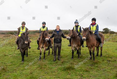 """Stock Picture of Adam Henson joins The annual round up of the Anchor Herd of Exmoor Ponies was held today on Exmoor The herd are gathered in off the moor for their annual health checks. The Exmoor has been given """"endangered"""" status by the Rare Breeds Survival Trust, and """"threatened"""" status by The Livestock Conservancy. It is one of the British Isles' mountain and moorland pony breeds, having conformation similar to that of other cold-weather-adapted pony breeds. The Exmoor pony is hardy and used for a variety of equestrian activities. In its free-roaming state, the breed's presence on Exmoor contributes to the conservation and management of several natural pasture habitats. Adam Henson of BBC tv country file at The annual round up of the Anchor Herd of Exmoor Ponies on Winsford Hill, Exmoor. The herd are gathered in off the moor for their annual health checks. The Exmoor has been given """"endangered"""" status by the Rare Breeds Survival Trust, and """"threatened"""" status by The Livestock Conservancy. It is one of the British Isles' mountain and moorland pony breeds, having conformation similar to that of other cold-weather-adapted pony breeds. The Exmoor pony is hardy and used for a variety of equestrian activities. In its free-roaming state, the breed's presence on Exmoor contributes to the conservation and management of several natural pasture habitats."""