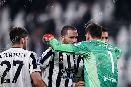 Stock Picture of Juventus defender Leonardo Bonucci (19) and Juventus goalkeeper Wojciech Szczesny (1) celebrate victory after the Serie A football match n.8 JUVENTUS - ROMA on October 17, 2021 at the Allianz Stadium in Turin, Piedmont, Italy. Final result: Juventus-Roma 1-0.