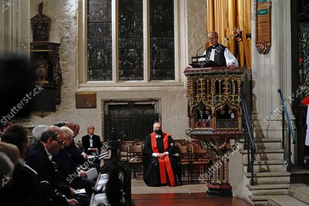 The Archbishop of Canterbury Justin Welby, top right, speaks during a service of remembrance for British MP David Amess at St Margaret's Church in Westminster in London, . British lawmaker David Amess was killed on Friday during a meeting with constituents at the Belfairs Methodist church, in Leigh-on-Sea, Essex, England