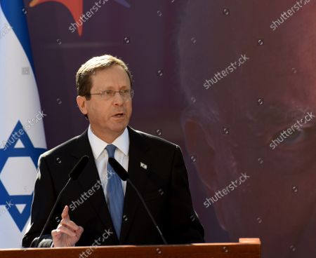 Israeli President Yitzhak Herzog speaks at the state memorial ceremony for the late Prime Minister Yitzhak Rabin at the Mt. Herzl Cemetery in Jerusalem, on Monday, October 18, 2021. Israel is marking 26 years since PM Rabin was assassinated by Yigal Amir, an extremist Jewish Israeli.