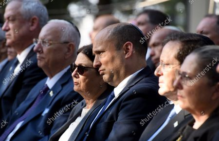 Israeli Prime Minister Naftali Bennett (C) attends the state memorial ceremony for the late Prime Minister Yitzhak Rabin at the Mt. Herzl Cemetery in Jerusalem, on Monday, October 18, 2021. Israel is marking 26 years since PM Rabin was assassinated by Yigal Amir, an extremist Jewish Israeli.