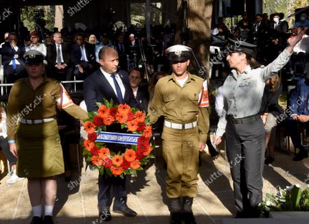 Israeli Prime Minister Naftali Bennett prepares to hang a wreath at the state memorial ceremony for the late Prime Minister Yitzhak Rabin at the Mt. Herzl Cemetery in Jerusalem, on Monday, October 18, 2021. Israel is marking 26 years since PM Rabin was assassinated by Yigal Amir, an extremist Jewish Israeli.