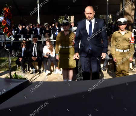 Israeli Prime Minister Naftali Bennett pauses in front of the grave of the late Prime Minister Yitzhak Rabin at the state memorial ceremony for the late Prime Minister Yitzhak Rabin at the Mt. Herzl Cemetery in Jerusalem, on Monday, October 18, 2021. Israel is marking 26 years since PM Rabin was assassinated by Yigal Amir, an extremist Jewish Israeli.