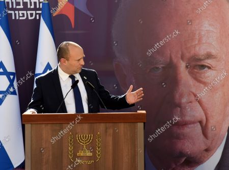 Stock Photo of Israeli Prime Minister Naftali Bennett speaks at the state memorial ceremony for the late Prime Minister Yitzhak Rabin at the Mt. Herzl Cemetery in Jerusalem, on Monday, October 18, 2021. Israel is marking 26 years since PM Rabin was assassinated by Yigal Amir, an extremist Jewish Israeli.