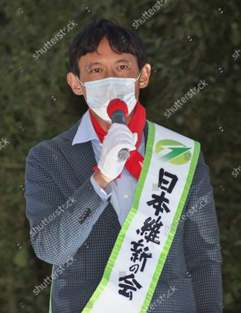 Stock Picture of Former vice governor of Kumamoto Prefecture, Taisuke Ono delivers a campaign speech as he runs for the upcoming general election in Tokyo, Japan.