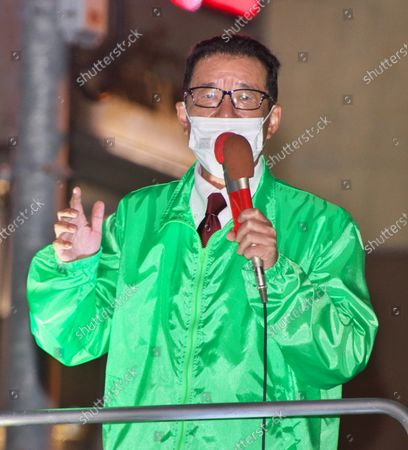 Stock Photo of Osaka Mayor and Japan Restoration Party leader, Ichiro Matsui delivers a campaign speech for his party's candidate as he runs for the upcoming general election in Tokyo, Japan.