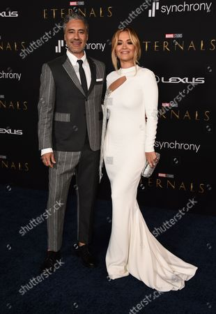 """Stock Photo of Taika Waititi and Rita Ora arrive at the premiere of """"Eternals"""" on Monday, Oct. 18. 2021, in Los Angeles"""