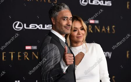 """Rita Ora, right, and Taika Waititi arrive at the premiere of """"Eternals"""" on Monday, Oct. 18. 2021, in Los Angeles"""