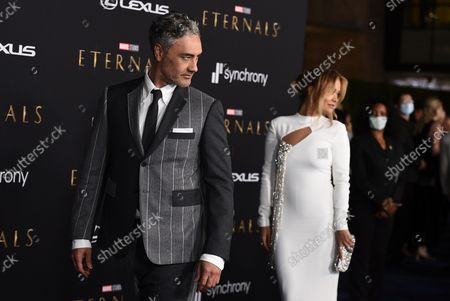 """Stock Picture of Rita Ora, right, and Taika Waititi arrive at the premiere of """"Eternals"""" on Monday, Oct. 18. 2021, in Los Angeles"""