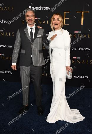 """Taika Waititi and Rita Ora arrive at the premiere of """"Eternals"""" on Monday, Oct. 18. 2021, in Los Angeles"""